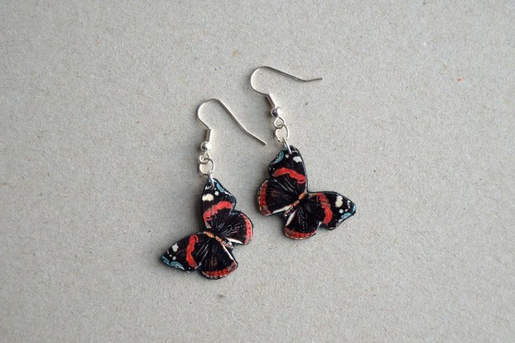 Earrings made of leather and pictures of butterflies. Minka / www.madeby.fi
