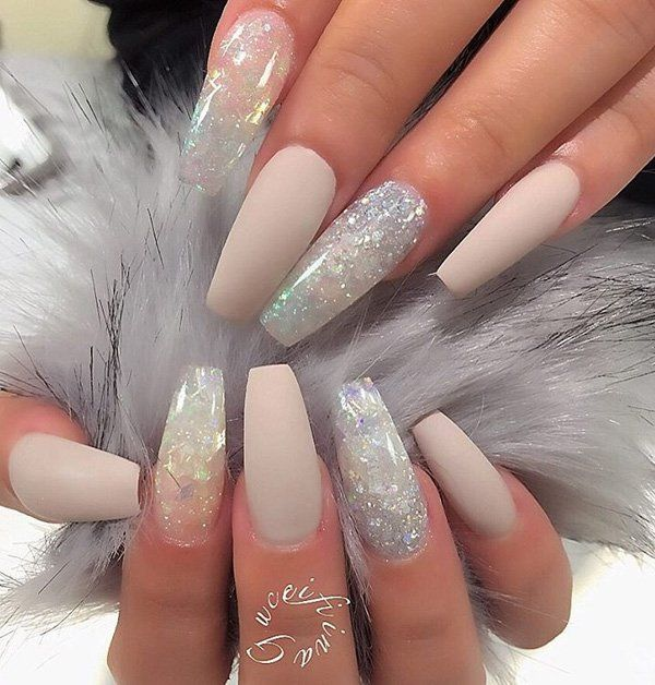Matte naked colors are the rage now. But you can make the other nails look glass-like with white rhinestones and glitters.