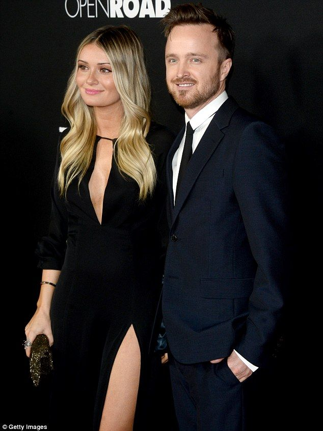 Upstaged! Aaron Paul was the star of the movie but his blonde wife Lauren Parsekian won all the attention at the LA premiere of Triple 9 on Tuesday night