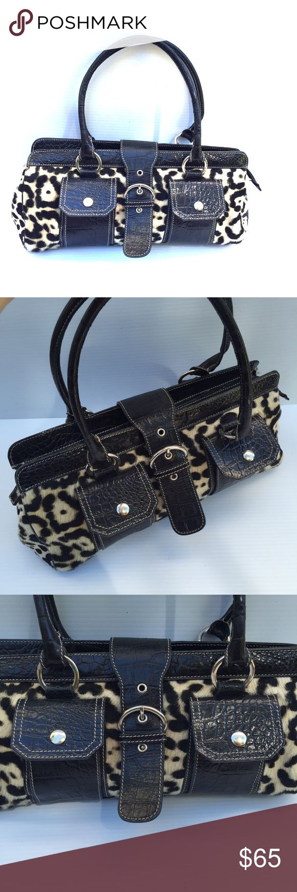 "Saks Fifth Avenue Black animal print Satchel For Sale Black Embossed Leather Animal Print Satchel. 💯 embossed croc leather. 💯 printed cowhide detail. 📢Made in Italy. Gently used. Great condition. Two small front pockets. One inside zippered pocket. Measures: L 15.5"" W 6"" H 6.5"" Handle drop 8"" Saks Fifth Avenue Bags Satchels"