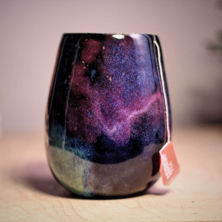 Cup the cosmos in your hands with this Stellar Cup. It has a notch in the side to keep your tea bag string in place.