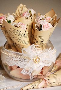Sheet music cones with roses- you can print sheet music paper now from websites instead of later and keep them in a project folder. Buy lace at flea markets, yard sales ie to save big $$$ that includes buttons and pretty necklaces or stringed beads and all things lovely :)