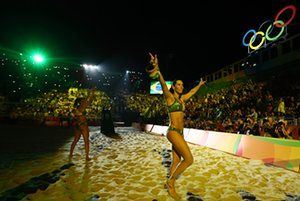 Beach Volleyball - Olympics: Day 12RIO DE JANEIRO, BRAZIL - AUGUST 17: Agatha Bednarczuk Rippel of Brazil and Barbara Seixas de Freitas of Brazil wave to the crowd before the Beach Volleyball Women's Gold medal match against Laura Ludwig of Germany and Kira Walkenhorst of Germany on day 12 of the Rio 2016 Olympic Games at the Beach Volleyball Arena on August 17, 2016 in Rio de Janeiro, Brazil. (Photo by Ezra Shaw/Getty Images)