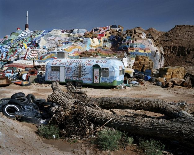 Slab City or The Slabs (located at 33°15′32″N 115°27′59″W) is a camp in the Colorado Desert in southeastern California, used by recreational vehicle owners and squatters from across North America. It takes its name from the concrete slabs and pylons that remain from the abandoned World War II Marine barracks Camp Dunlap there. A group of servicemen remained after the base closed, and the place has been inhabited ever since, although the number of residents has declined since the mid 1980s.