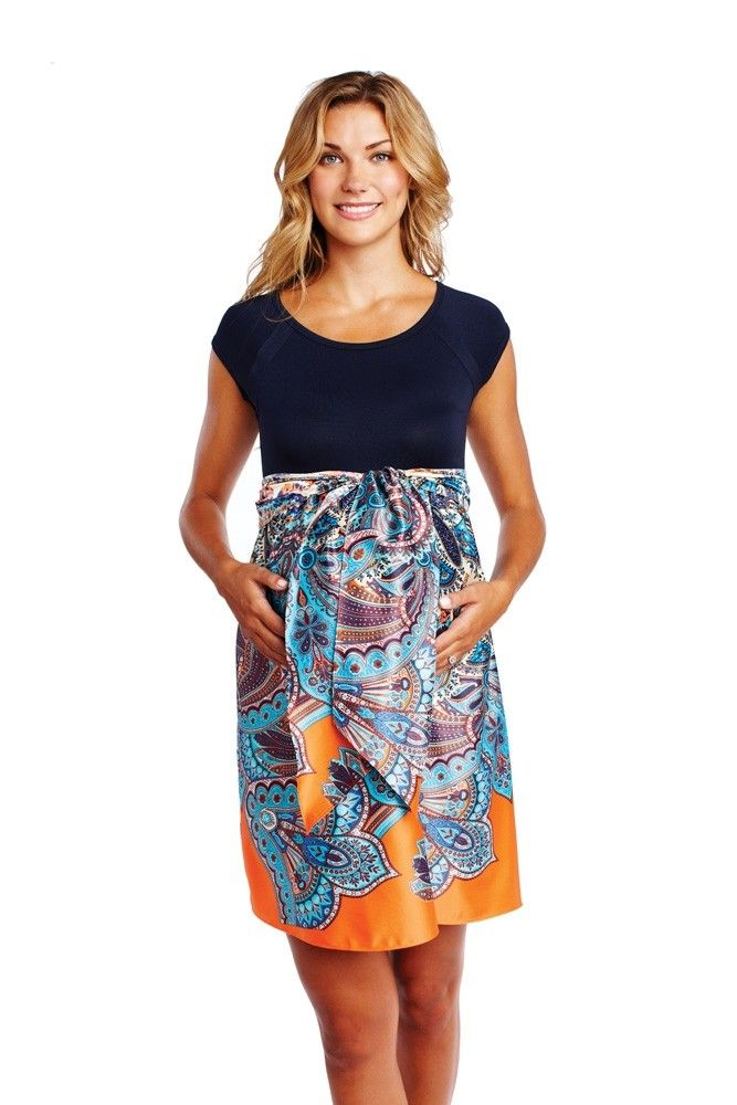 A navy color-blocking look with a bright stylish paisley print skirt and a beautiful, matching tie silk sash. Designed with a comfortable scoop-neck top with empire styling. A lovely maternity dress for all occasions.