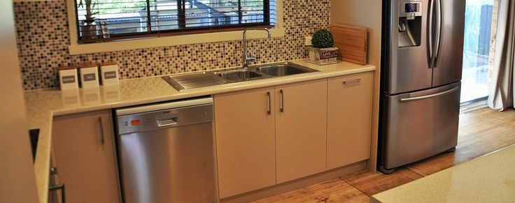 Renovated Kitchen with mosaic splash back (very 'in'!), laminate bench tops and soft close doors and drawers.