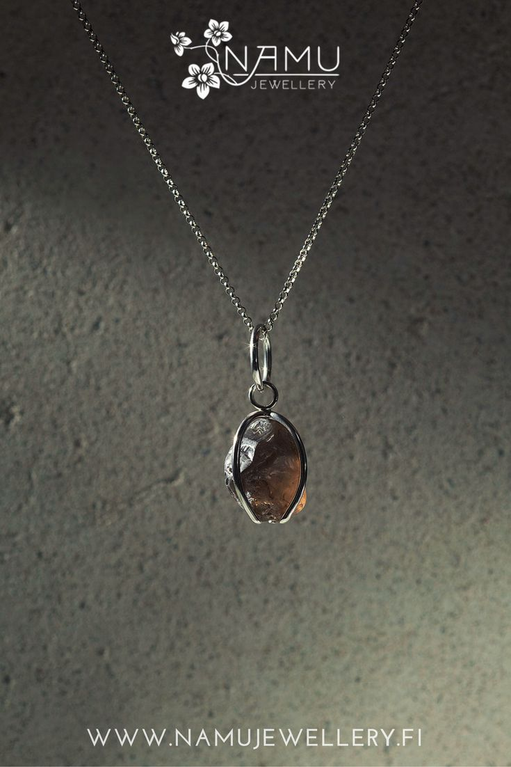 Karu One dark smokey quartz pendant. Karu is made of recycled tensed silver wire and ethically sourced hammered stone. It is rough and edgy and it has an attitude.