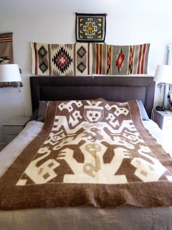 A beautiful Peruvian blanket with an intricate pictorial scene.