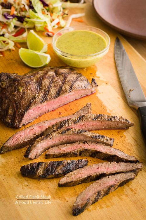 Grilled flank steak with  Mexican marinade that doubles as a sauce. Great flavors of cilantro, olive oil, cumin, chili, lime juice and more. Tangy and terrific!