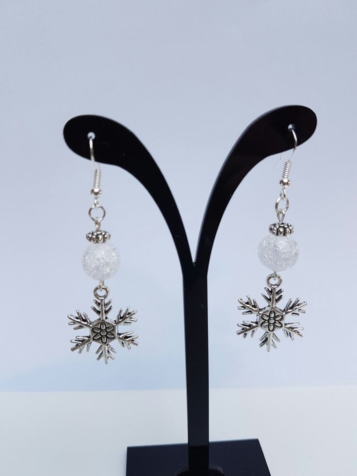Cracked crystal and silver plated charms. Just love the snowflakes. 925 silver ear hooks.