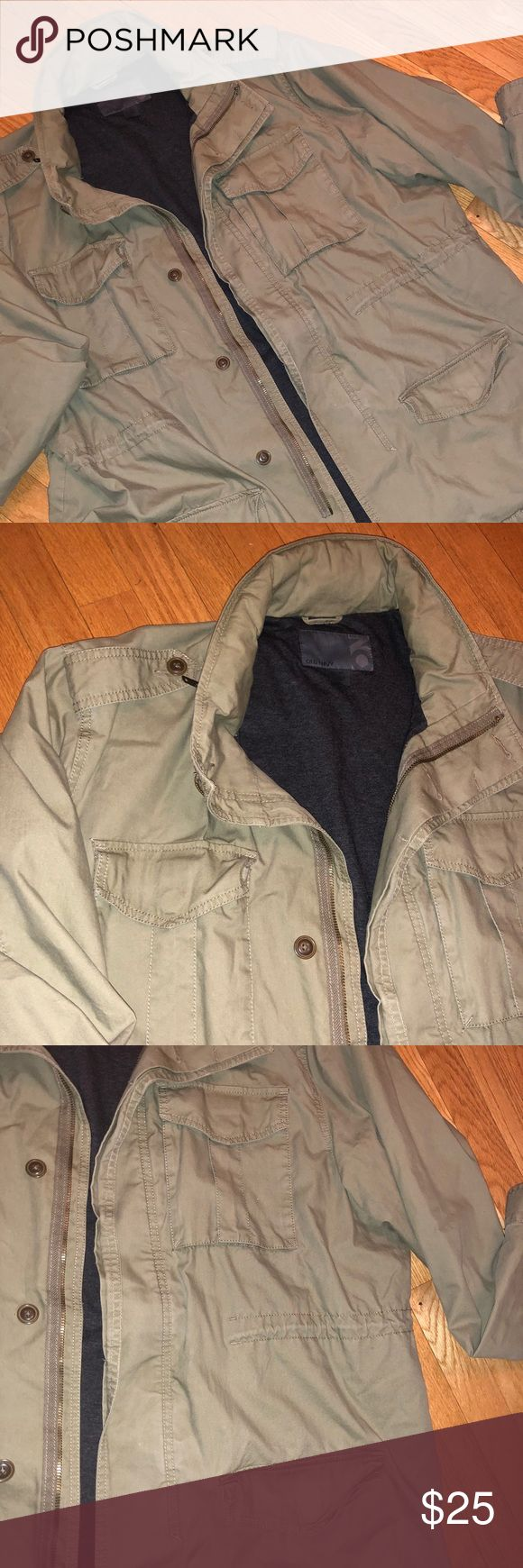 🆕Olive Green Military Style Hooded Jacket XXL Like new condition. Olive Green military jacket w/ zip hood feature at the back of collar- nice to be able to roll it up when not needed/ in use. Inner light fleece/cotton lining in charcoal gray. Ties on the inner parts of both sides of the jacket above the pockets for adjusting, if you choose. Love this jacket- bought it for him, he wore it like twice. Clothes addict...🤷🏻‍♂️🙈👟 Old Navy Jackets & Coats Military & Field