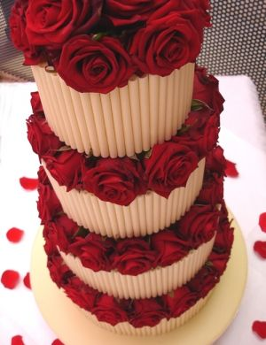 Chocolate cigarello with Grand Prix roses | Nicky Grant Wedding Cakes and Favours