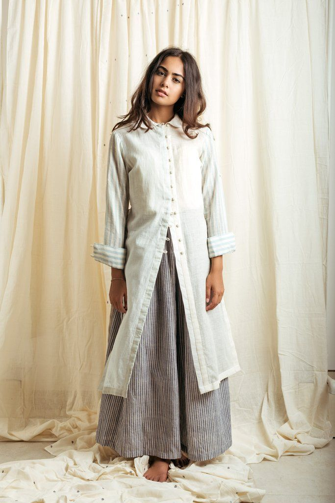 'its liked being cloaked inthe blue sky and clouds'This shirtis crafted from hand-spun khadimuslin with dent gaps in the fabric, that creates an illusion of sheer stripes in the fabric,withcontrast striped sleeves.DETAILS -Khadi Muslin (dent gap technique)-Handwoven-straight cut silhouette with slits-Loose and relaxed fit at the waist-shirt collar-striped long shirt sleeves with cuff details-this shirt is lined-Dry clean only-the dress come with a plain cotton slip-This garment...