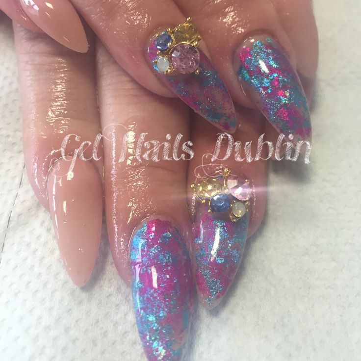 Nude acrylics with nail art foils & diamond gem