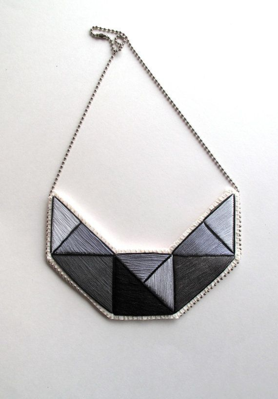 Bib necklace hand embroidered with light and dark gray colors outlined in black with geometric design Fall and Winter fashion