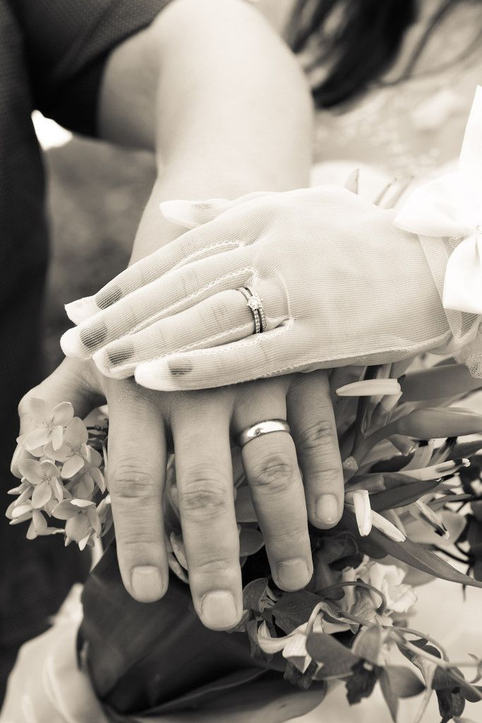 Bride wearing gloves with diamonds ring and the groom with gold ring at the Warwick, Fiji. Photographed by Anais Photography.