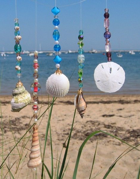 Try this! Grab or collect as many shells as you can find later get a string but not too heavy and start to tie the string around the shells and sand dollars, attach to a peaceful and cute place and... Your done!