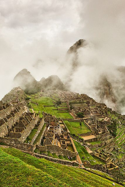 Ancient ruins of Machu Picchu in fog, Peru, by Joerg Bonner