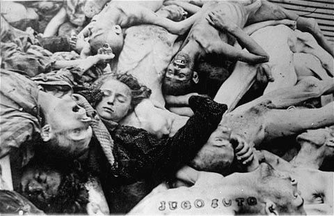 The first thing that catches my eye is the angelic face of that beautiful baby laying  against the carnage.         A pile of corpses in the newly liberated Dachau concentration camp. Dachau, Germany, April 29-May 1945.