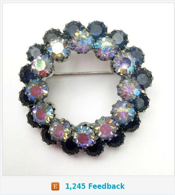 Blue Rhinestone Wreath Brooch - mid century - aurora borealis - blue Crystal Round pin https://www.etsy.com/serendipitytreasure/listing/583112555/blue-rhinestone-wreath-brooch-mid?ref=listing_published_alert