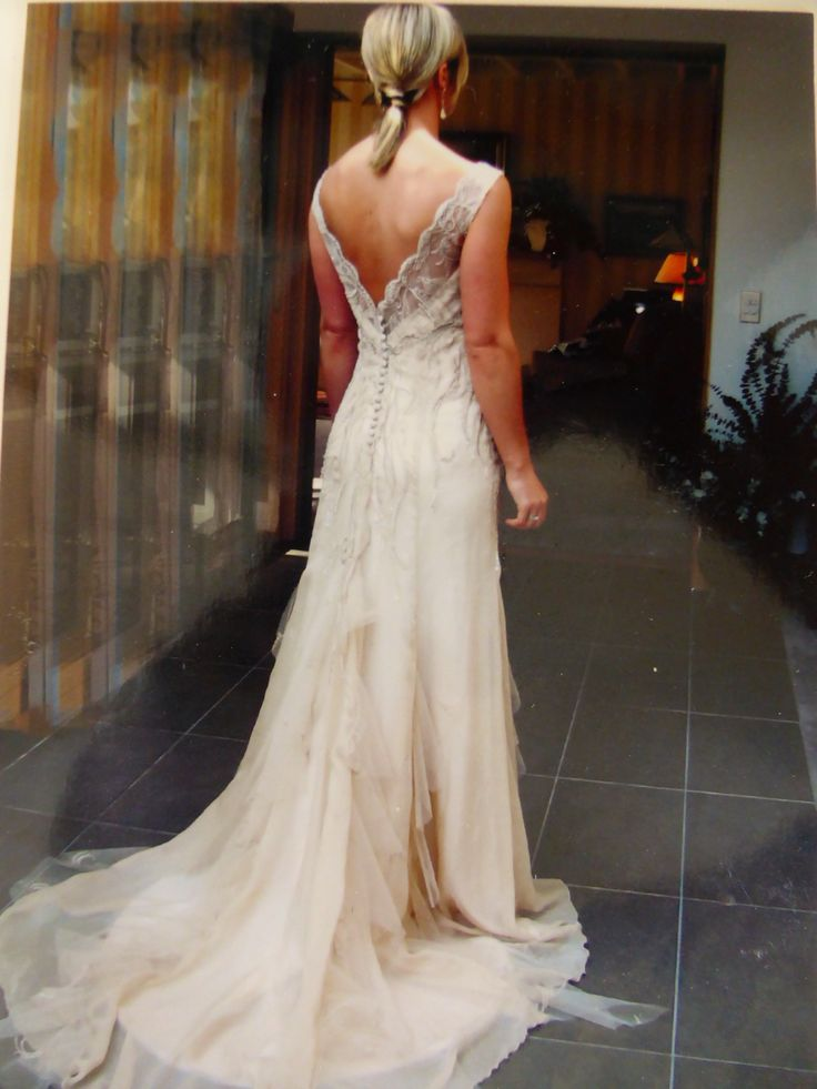 Champagne gown with lace hand sewn down gown to hip line