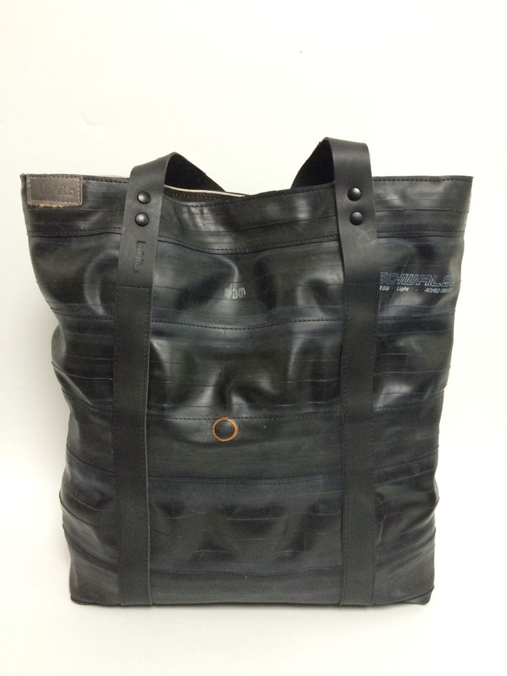 Big shopper, made of used and new innertubes and black leather. Lining white sail of the sailboat.