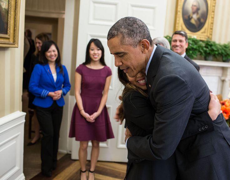 """""""When Nina Pham walked into the Oval Office, the President gave her a big hug as her family and White House Dr. Ronny Jackson watched. Nina, a Dallas nurse diagnosed with Ebola after caring for an infected patient in Texas, was being treated at the National Institutes of Health in nearby Bethesda, Maryland, and the President invited her to the White House when she was released after being declared Ebola-free."""" (Official White House Photo by Pete Souza)"""