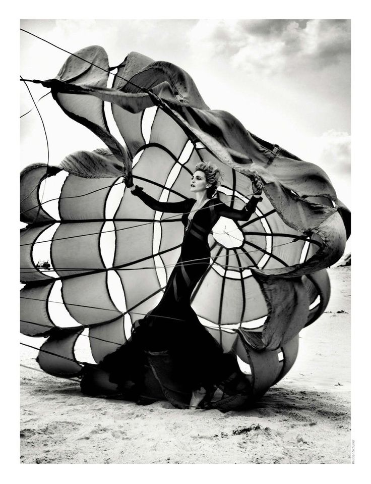 Love the balanced lighting between the model and the clouds. I like how the parachute is still in the air although it has already landed on the ground and that connects well with the dress that the model is wearing