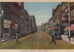 King at Frederick: Standing in the middle of the streetcar tracks on King Street and looking west, the camera captured a late 1930s sunny day in downtown Kitchener. Halfway down the streetscape on the left is the Walper Hotel and directly across is the American Hotel block.