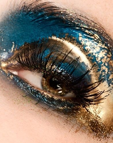 I could never wear this, but it's so cool!  Glitter, plus gold foil, plus turquoise shadow, plus false eyelashes
