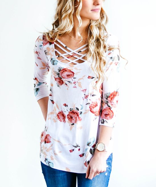 Embrace your feminine side with this floral top. Spandex fibers allow the lightweight fabric to stretch for a flattering fit.Size S: 26'' long from high point of shoulder to hem95% polyester / 5% spandexHand wash; hang dryMade in the USA