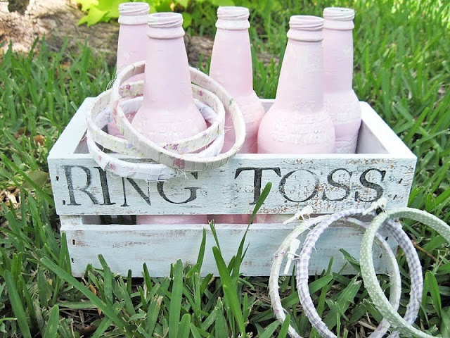 DIY Ring Toss Game ~ painted IBC Root Beer Bottles & fabric covered embroidery hoops.... So many games for singing time that could be done with this