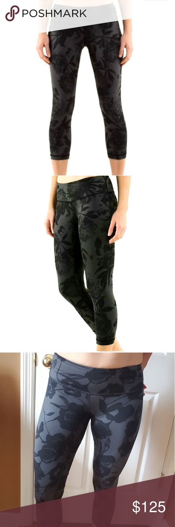 """Lululemon Brisk Bloom Black Floral Crop Leggings 4 NO TRADES. PRICE FIRM.  Beautiful, excellent condition. Worn once. Size 4. 2nd pic is a stock photo. Pics taken in various lighting so you can get an idea of the colors. Reversible.  For reference, I have a 27"""" true waist and 37"""" hip and a size 4 is perfect on me. lululemon athletica Pants Leggings"""