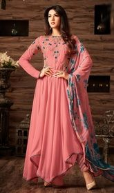 Asymmetrical Anarkali Suit in Pink Color Georgette #cbazaaranarkalichuridar #anarkaliindiandress True magnificence will come out from your dressing trend with this asymmetrical Anarkali suit in pink color georgette. This stunning attire is displaying some remarkable embroidery done with lace and resham work. USD $ 125 (Around £ 86 & Euro 95)