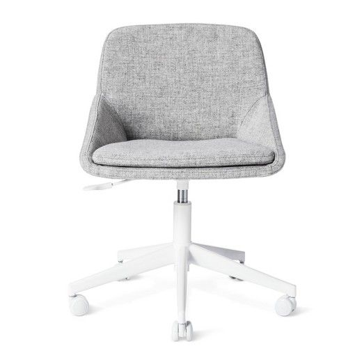 The Modern by Dwell Magazine Desk Chair has a five-pronged base with wheels so you can scoot from filing cabinet and back easily. This rolling office chair has a lever to adjust the height and neutral fabric to blend anywhere.