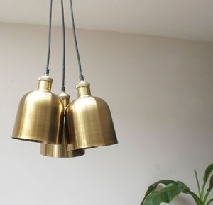 Cluster Of Brass Pendants - Decorative lighting is becoming an artform in itself, with designs that catch the eye whether the bulb is on or off. Consider mixing different styles with complementary tones or mixed metals. Perfect for any living room.
