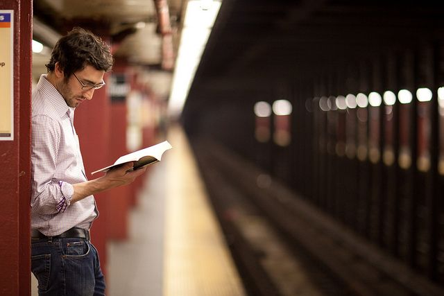 Waiting and Reading at 34th Street by pamhule, via Flickr