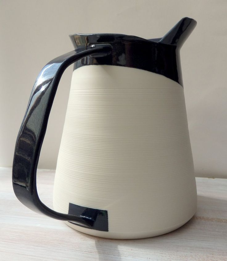 tall porcelain pitcher form with asymmetrical rim