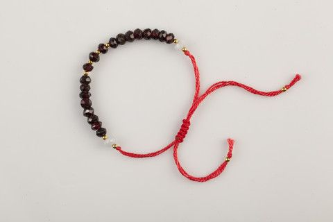 Handmade adjustable bracelets are made by quartz and special thread, to give a fine finish to your entire clothing. Coloured in Granade and a bright red colored thread, a fiery detail that will make a statement.