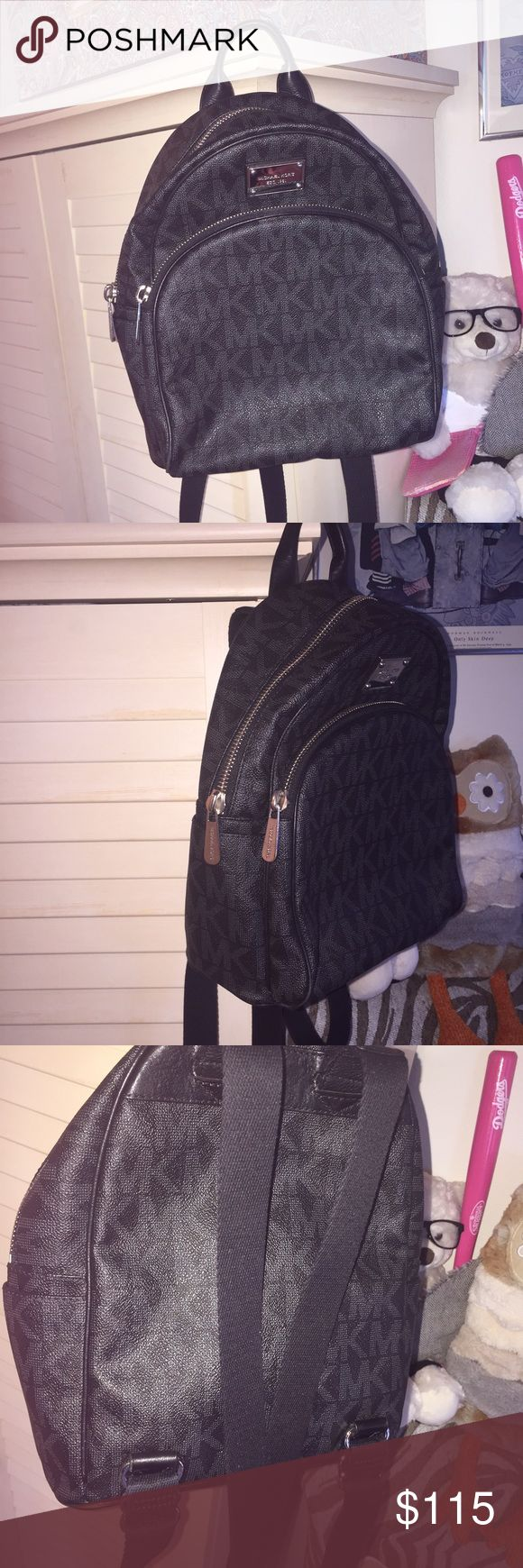Michael Kors Black Signature Backpack Small FIRM small size. not the mini. ample room for things but not as big as a school backpack. has been used rate 8.5/10. clean, barely any wear to bag other than the hardware having slight scratches and the straps having slight piling as they are fabric. super comfy on shoulder because strap is fabric. no offers please, selling low. authentic. no dustbag sorry Michael Kors Bags Backpacks