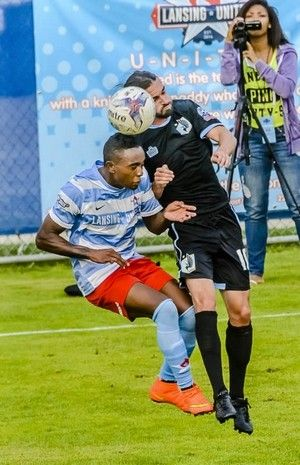 Brian Cunningham (left) of Lansing United and Akil Howard of Minnesota United Reserves head the ball during their game Saturday. My head is harder than yours.