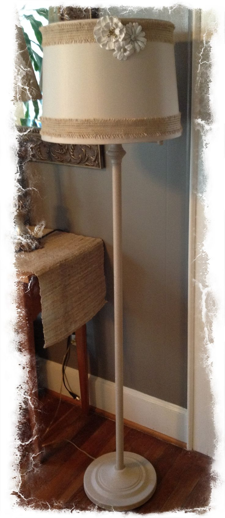 Plain floor lamp sprayed w/textured paint.  Lamp shade embellished with jute ribbon and flower decals.