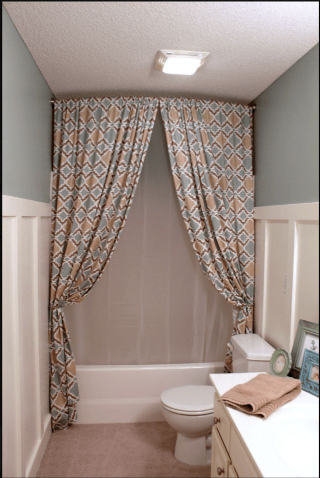 Hang A Shower Curtain All The Way Up To The Ceiling To Make The Room Feel