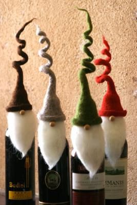 "curly hat santa wine toppers    Wine toppers make the gift of wine incredibly special, and these charming santas with whimsical, curly hats will be an instant hit at any holiday party this season!     Set of four. One of each color.     11""t  Item ID: 560-10109          6    Tell a Friend        $39.00"