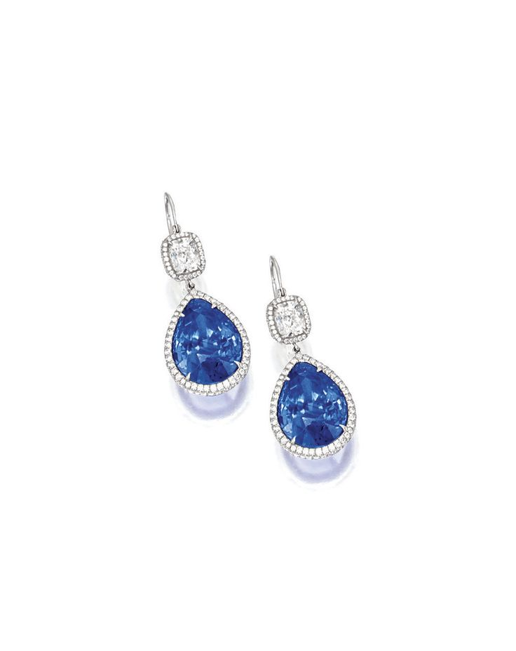 PAIR OF SAPPHIRE AND DIAMOND PENDENT EARRINGS | Each suspending on a pear-shaped sapphire weighing 11.68 and 11.68 carats respectively, natural, of Ceylon origin, with no indication of clarity enhancement, surmounted by a cushion-shaped diamond, to a frame set with brilliant-cut diamonds, the diamonds altogether weighing approximately 3.10 carats, mounted in platinum. | Sotheby's