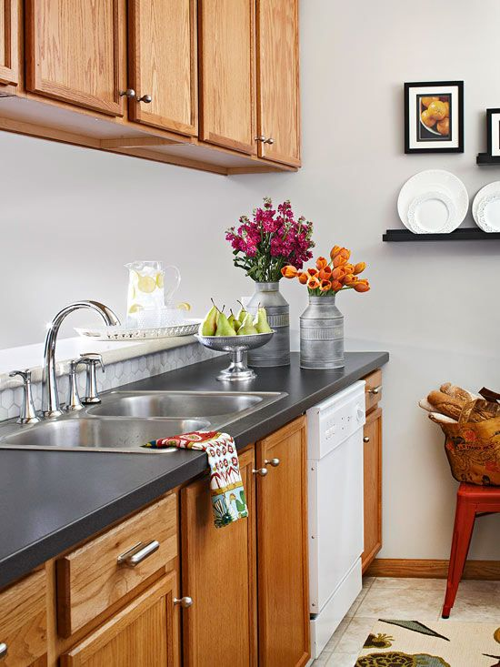 Kitchen Updates on a Budget Fresh Slate Countertops were the major change in the makeover of this 10x9-foot galley kitchen. The clean-lined laminate countertops in a slightly speckled charcoal give the kitchen a contemporary feel and allow brighter accents to take center stage.