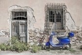Scooter : Vintage image of blue Italian scooter in Roma, Italia.Vintage Image