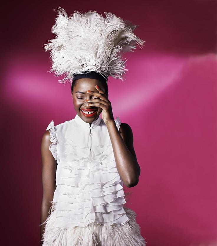 Chiffon cascade blouse and Ostrich feather headwear *Africa