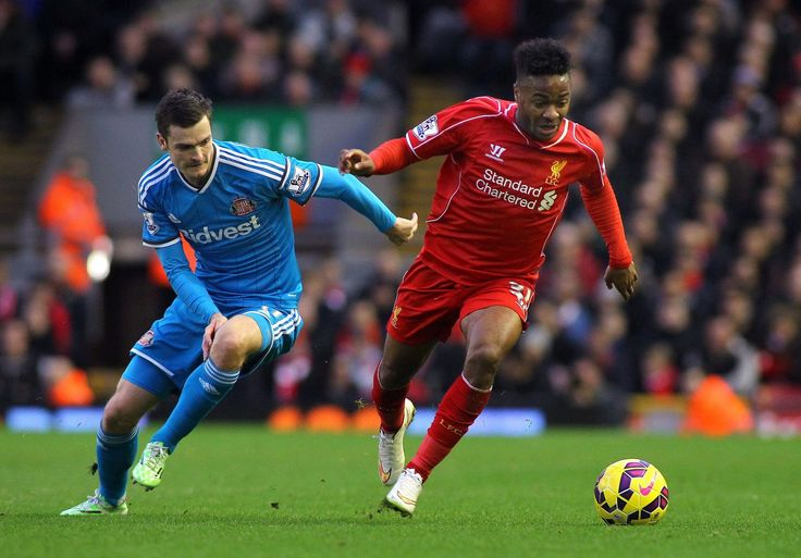 Adam Johnson of Sunderland (L) and Raheem Sterling of Liverpool in action