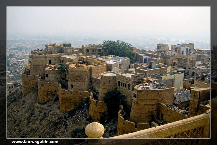 The Jaisalmer Fort is located in the heart of the city and is known for its miniatures, architecture and bazaars. This fort was built in 1156 by a Bhati Rajput ruler Jaisal, atop the Trikura hill. About a quarter of the population of Jaisalmer live inside this fort.  The fort is also called the Sonar Quila and is regarded as 'The Pride of Jaisalmer'. The 250 feet tall fort is protected by a 30 feet tall wall surrounding it on all sides.